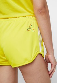 adidas Originals - PHARRELL WILLIAMS 3 STRIPES - Shorts - yellow