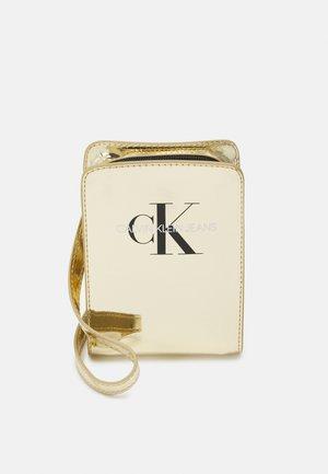 MONOGRAM POUCH - Across body bag - gold-coloured