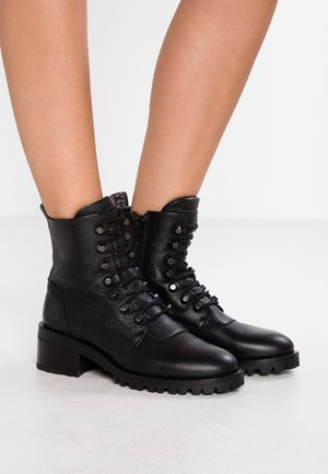 DJUNA CONE - Lace-up ankle boots - black