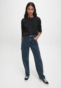 Calvin Klein Jeans - Sweatshirt - ck black - 1