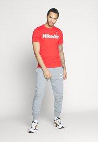 Nike Sportswear - AIR TEE - Print T-shirt - university red/white - 1