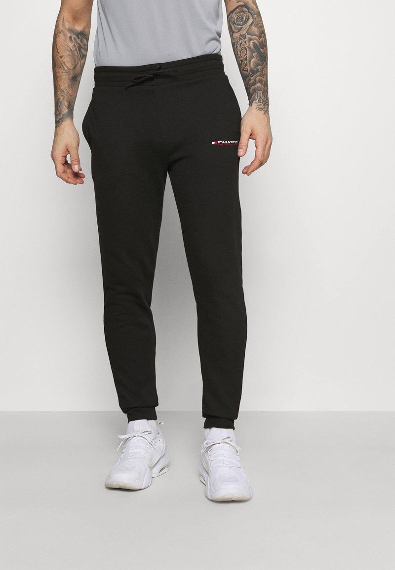 Tommy Hilfiger - LOGO - Spodnie treningowe - black