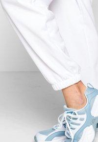 Kappa - IVYNALA - Tracksuit bottoms - bright white - 5