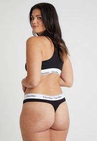 Calvin Klein Underwear - MODERN PLUS THONG - Thong - black - 2