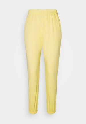 BASIC - Tracksuit bottoms - yellow