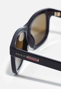 Gucci - UNISEX - Sonnenbrille - black/brown - 4
