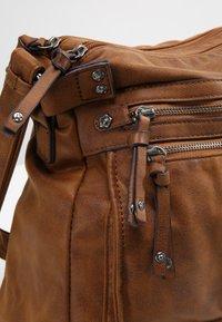 Tamaris - ULLA CROSSBODY BAG - Across body bag - brown - 5