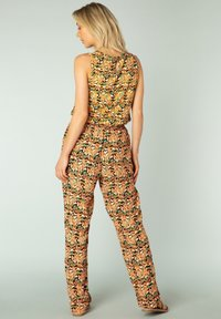Yest - KAYRA - Trousers - fresh orange/multico - 1