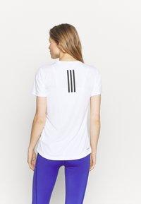 adidas Performance - NECESSI TEE - T-shirts med print - white/black - 2