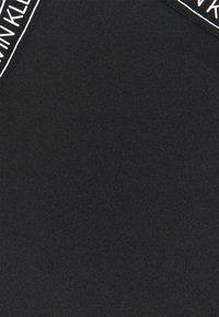Calvin Klein Swimwear - CORE LOGO TAPE BRALETTE - Bikini top - black - 6
