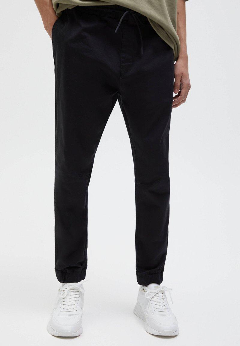 PULL&BEAR - Tracksuit bottoms - black