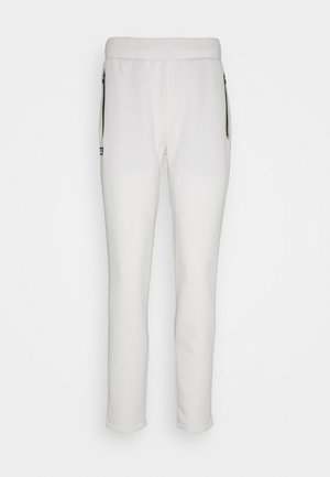 CITY - Tracksuit bottoms - flour/viennese-sabler-black