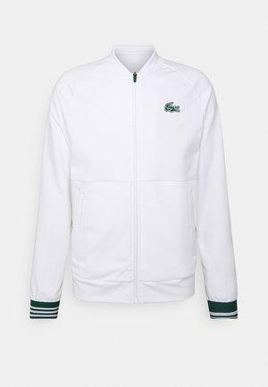 TENNIS JACKET MED - Training jacket - white/swing