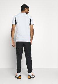 Nike Performance - DRY ACADEMY PANT - Pantaloni sportivi - black/white - 2