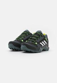 adidas Performance - TERREX AX3 - Hiking shoes - core black/footwear white/acid yellow - 1