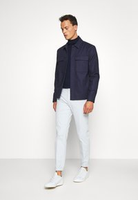 Tommy Hilfiger Tailored - FLEX SLIM FIT PANT - Trousers - grey - 1
