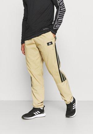 FUTURE ICONS - Pantaloni sportivi - beige tone