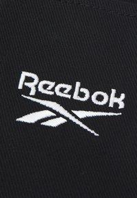 Reebok Classic - SMALL SLING BAG UNISEX - Across body bag - black - 4