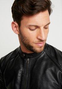 Produkt - PKTDLN DYLAN BIKER JACKET - Faux leather jacket - black - 3