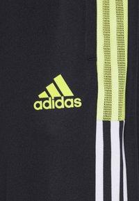 adidas Performance - TIRO  - Spodnie treningowe - black/yellow - 2
