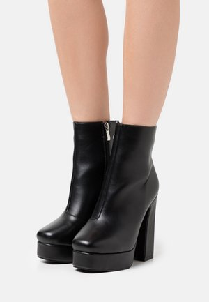 WIDE FIT CHAYA - Platform ankle boots - black
