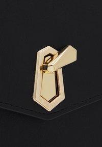 Pieces - PCADA CROSS BODY - Across body bag - black/gold-coloured - 3