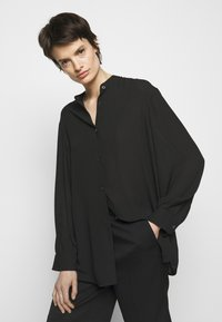 Filippa K - LAYLA BLOUSE - Button-down blouse - black - 3