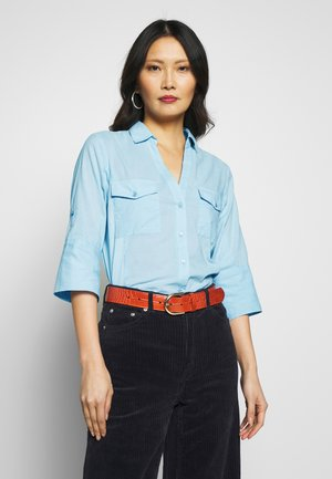 CORTNIA - Button-down blouse - chambray blue