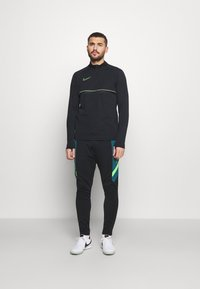 Nike Performance - Sports shirt - black/green strike - 1