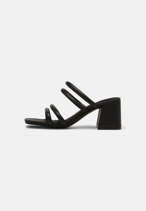 SHEER - Pantofle na podpatku - black