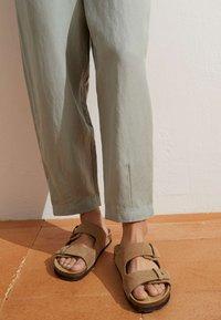 OYSHO - MIT LEINENANTEIL - Trousers - light green - 3