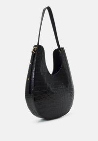 Coccinelle - BAGATELLE CROCO SHINY SOFT - Handbag - noir - 4