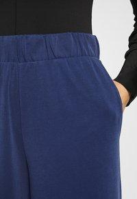 Monki - CILLA FANCY TROUSERS - Trousers - blue dark navy - 4