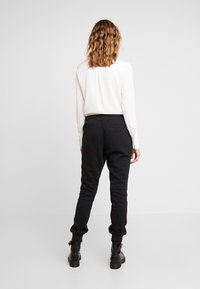 adidas Originals - R.Y.V. CUFFED SPORT PANTS - Tracksuit bottoms - black - 2
