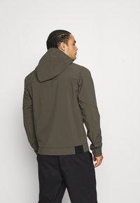 Peak Performance - ADVENTURE HOOD JACKET - Winter jacket - black/olive - 2