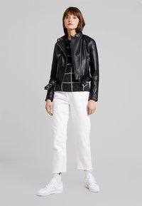 Vero Moda - VMEILEEN SHORT COATED JACKET - Faux leather jacket - black - 1