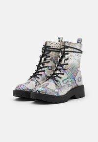 Steve Madden - JTORNADO - Lace-up ankle boots - beige - 1