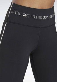Reebok - LES MILLS® HIGH-RISE 3/4 LEGGINGS - 3/4 sports trousers - black - 2