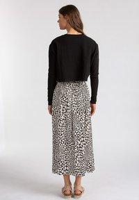 LOVJOI - A-line skirt - black - 2