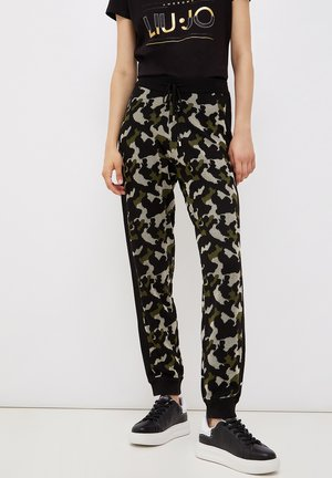 CAMOUFLAGE - Tracksuit bottoms - green