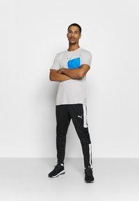Puma - TRAIN FIRST MILE XTREME TEE - Sports shirt - gray violet - 1