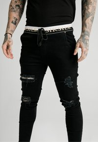SIKSILK - SIKSILK DELUXE LOW RISE - Jeans Skinny Fit - black - 4