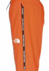 The North Face - Tracksuit bottoms - black-shocking orange - 2