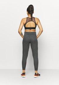 adidas Performance - Tracksuit bottoms - mottled dark grey - 2