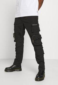 Mennace - MENNACE UTILITY TROUSER - Cargo trousers - black - 4