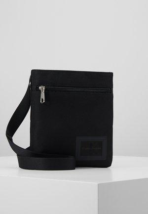 SPORT ESSENTIALS MICROFLAT - Across body bag - black