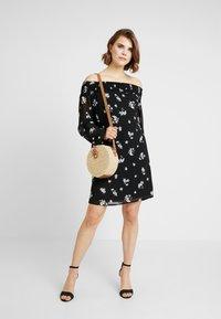 NA-KD - COWGIRL FLORAL PRINTED OFF SHOULDER DRESS - Day dress - black/white - 2