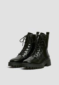 PULL&BEAR - LACKOPTIK - Platform ankle boots - black - 1