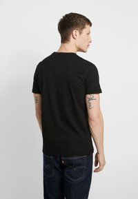 Alpha Industries - Print T-shirt - black - 2