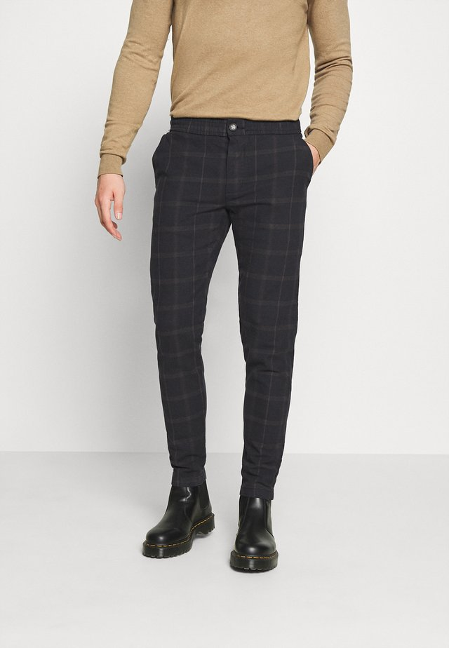 KING PANTS - Pantaloni - black